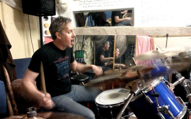 Tef drums and sings